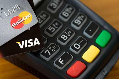 MCO планирует получить разрешение на выпуск криптовалютных дебетовых карт в Гонконге